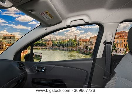 Looking Through A Car Window With View Over Adige River In Central Verona, Italy