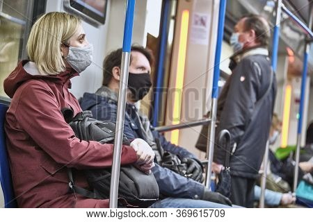 Russia Moscow June 2020. Moscow Metro. People In Protective Masks Ride In A Subway Car. Coronavirus