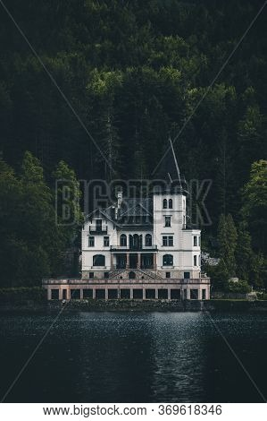 Famous Schloss Lake Grundlsee, Villa Castiglioni In Green Forest Reflected In Water.