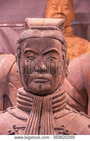 Xian, China - May 1, 2010: Terracotta Army Museuml.  Closeup Of Reddish Head Of Officer Sculpture Wi