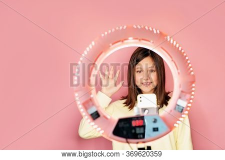 Young Beautiful Girl Leading Her Daily Vlog Online. Selfies. Copy Space. The Phone Is Mounted On A T