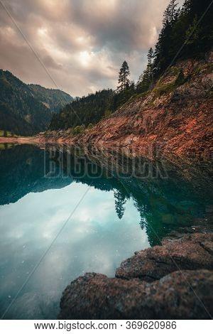 Misty Summer Morning On The Vorderer Gosausee Lake. Colorful Sunrise In Austrian Alps, Salzkammergut