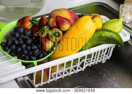 Fruits And Vegetables Being Disinfected After  Purchase During The Covid-19 Pandemic