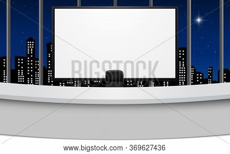 White Table And Lcd Tv In The News Studio Room With City In The Night Background