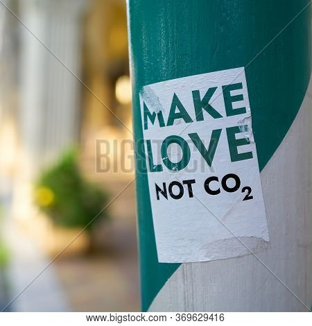 Sticker On A Pillar In Downtown Berlin With The Inscription Make Love Not Co2