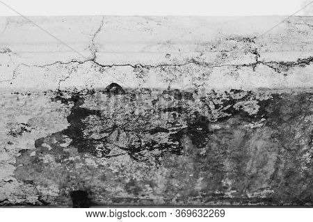Close-up Of White Cement Crack Wall And Peeled Paint Caused By Water And Sunlight. Peel Wall Of Whit