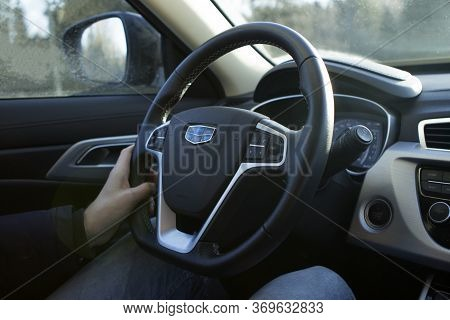 Minsk, Republic Of Belarus. 12.16.2019. Male Hands Hold The Wheel Of A New Car Geely Atlas