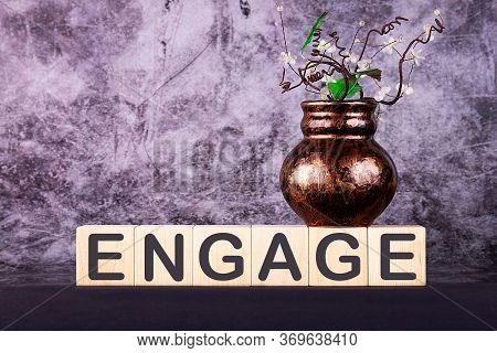 Word Engage Made With Wood Building Blocks On A Gray Back Ground