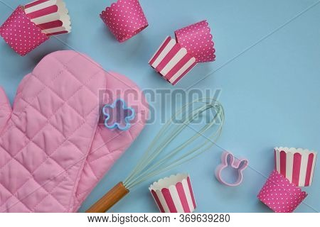Cupcakes Cooking. Muffins Recipe. Baking Tools.pink Muffin Molds, Whisk And Pink Mittens On A Light
