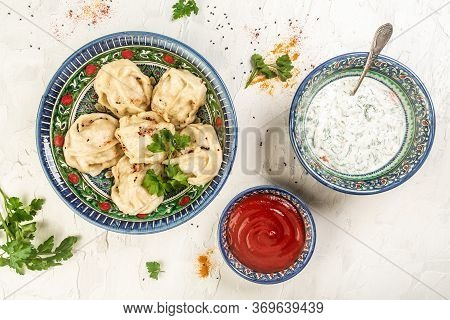Traditional Turkish Manti With Yoghurt. The Concept Of Oriental Cuisine. Uzbek Food Manti Or Manty D