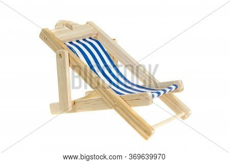 Beach Chair Isolated On White. Blue And White Striped Deck Chair.
