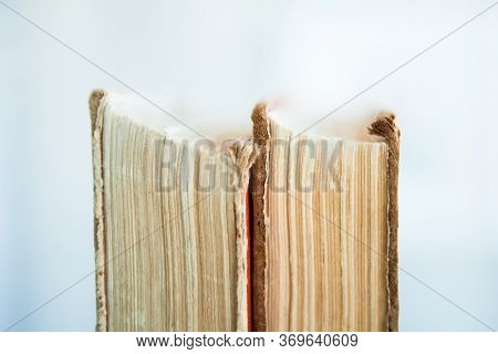 Stack Of Old Books On Light Background, Upright