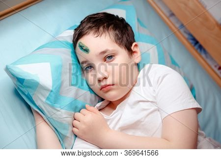 Child With An Injury To Forehead. Boy Is Upset About The Head Wound