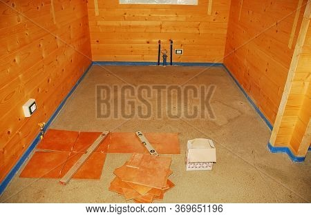 A Concrete Floor In A Newly Built Wooden (fir) House. Floor Tiling Adhesive Ihas Been Applied And Fl