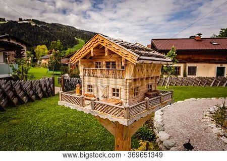 Little Miniature Bird House With Many Details Designed Like A Apartment Lodge In The Alps