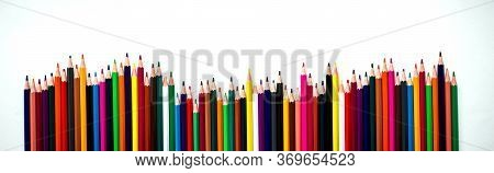 Row Of Different Colored Pencils. Rainbow Colored Pencils Are Jiggling Side By Side. School Accessor
