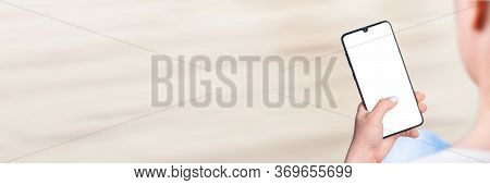 Woman's Hand Holding Cell Phone With Blank Screen, Woman Sitting And Holding Blank Screen Mock Up Mo