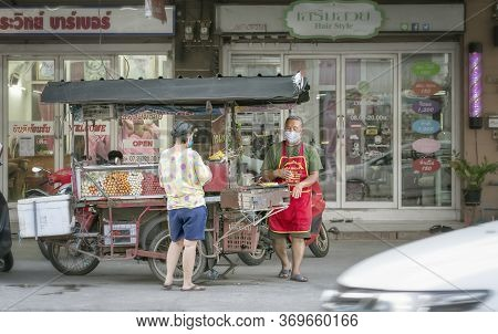 Bangkok, Thailand - June 04: Unnamed Street Food Vendor And Buyer Conducts Business On The Side Of T