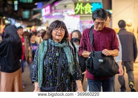 Taipei, Taiwan - January 05: Unnamed Elderly Woman Happily Walks In The Shilin Night Market In Taipe