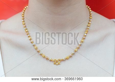 Close Up. Beautiful Neck Girl With Gold Necklace. Woman In A Golden Necklace Jewelery. Beauty And Ac