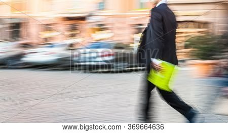 Soft Focus Blurred Abstract Image Of Business People In The Street. Intentional Motion Blur