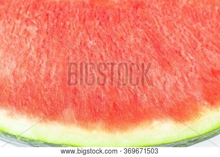 Red Texture Of Seedless Watermelon With Green Rind