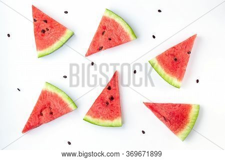 Slices Of Chopped Watermelon With Seeds Isolated On White Background. Summer Concept.