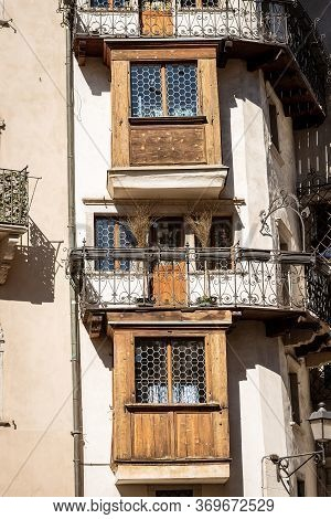Ancient Wooden And Wrought Iron Balconies In Trento Downtown, Trentino Alto Adige, Italy, Europe