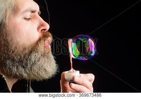 Closeup Portrait Of Man Blowing Bubbles. Soap Bubbles. Play With Bubbles. Bearded Man Blowing Soap B