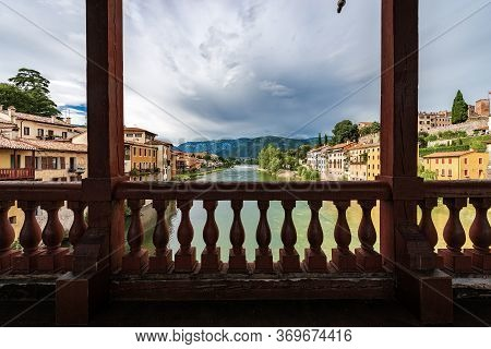Bassano Del Grappa Town And The River Brenta Seen From The Famous Ponte Degli Alpini Or Ponte Vecchi
