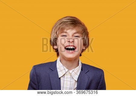 Loud Laughter Of A Beautiful Little Blond Boy In A White Shirt.
