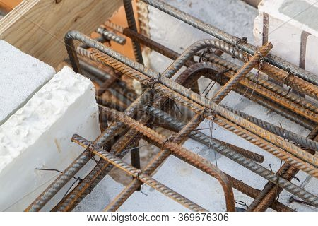View Of Reinforcement Of Concrete With Metal Rods Connected By Wire. Preparation For Pouring The Fou
