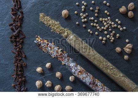 Various Spices And Herbs On A Textured Background. Set Of Spices And Herbs. Pepper, Salt, Cloves, Ba