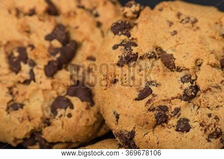 Texture Of Cookie With Chocolate. Close Up Of Chocolate Chip Cookies, Stacked Chocolate Chip Cookies