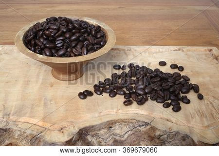 Sumatra Mandheling Coffee Beans In A Wooden Bowl And Spread Out Before It.