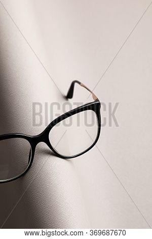 Stylish Eyeglasses Over Gray  Background. Optical Store, Glasses Selection, Eye Test, Vision Examina