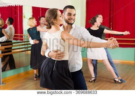 Positive Spanish Men And Women Enjoying Of Tango In Class.