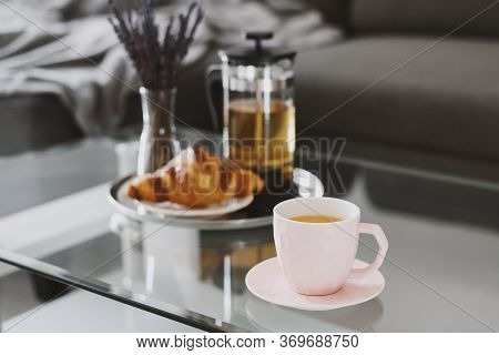 Herbal Tea In A Pink Cup, Fresh Croissant, French Press Tea Pot And Dried Lavender Bouquet Served On