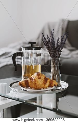 Croissant Served On A Metal Tray With Herbal Tea And Dried Lavender Bouquet. Breakfast On A Coffee T