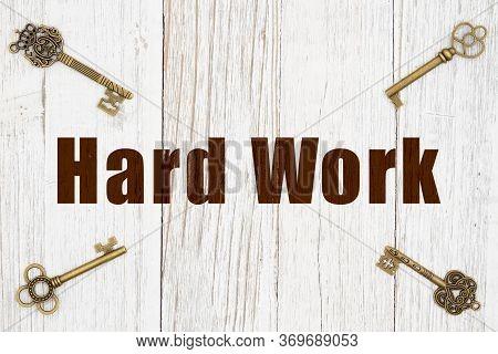 Key To Success Is Hard Work Message With Skeleton Keys On Weathered Whitewash Wood