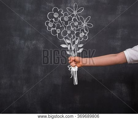 Child\'s Hand With Flower On Mother\'s Day. Flower\'s Drawn On Chalkboard. Cope Space. Back To Schoo