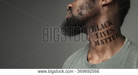 Close Up Black Man Tired Of Racial Discrimination Has Tattooed Slogan Black Lives Matter On His Neck