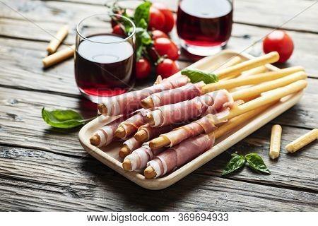 Italian Antipasto With Brad Sticks And Pork Ham