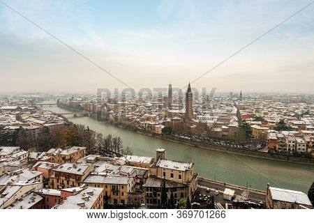 Aerial View Of Verona Downtown In Winter With Snow. Adige River, Church Of Santa Anastasia And Medie