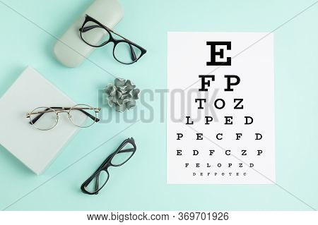 Collection Of Eyeglasses With Eye Test Table. Optical Store, Glasses Selection, Eye Test, Vision Exa