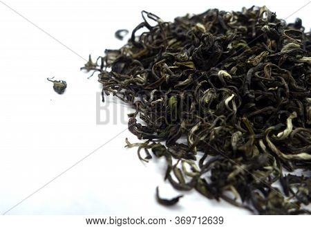 Dry Green Tea Isolated On White With Blur Effect. Food And Ingredients Background.
