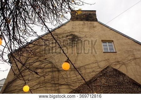 Old House Wall And Lamps Outside. Urban Background.