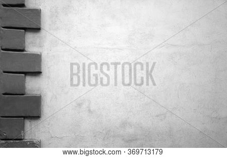 Concrete Wall With Decor Brick Style. Space For Your Text