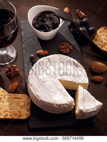 Appetizers Table With French Cheese Camembert Amd Grapes For Buffet Aperitif Party.