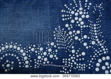Beautiful Decoration From White Rivets On Denim Clothes